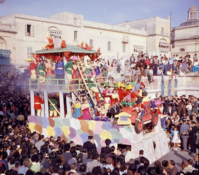 Carnival floats pass the ruins of the Royal Opera House 1950s