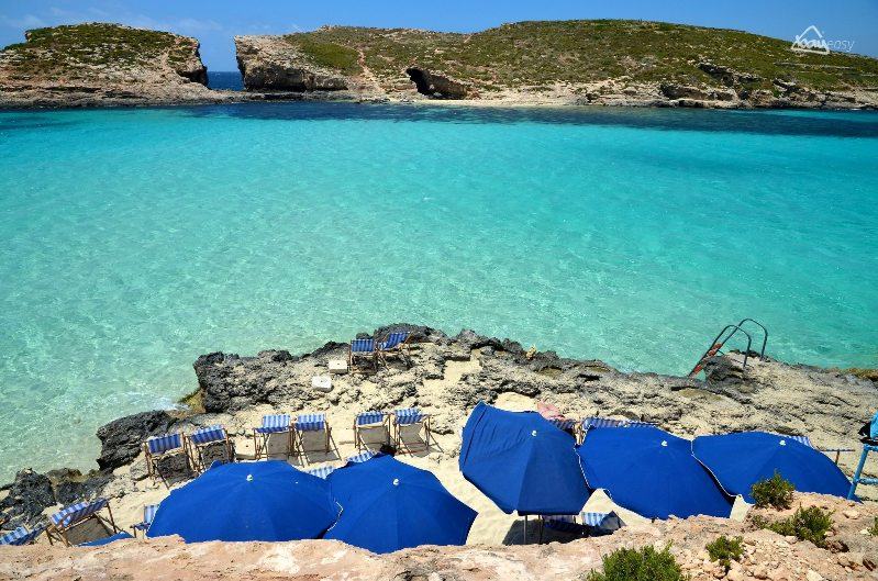 Comino blue lagoon, malta deckchairs in thesummer